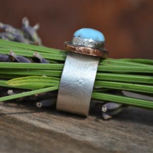 Zilveren ring met Larimar en koper