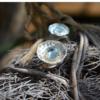 Zilveren ring met aquamarijn in gouden zetting, handgemaakt