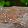 Halsketting zilverbuis en titaniumdraad