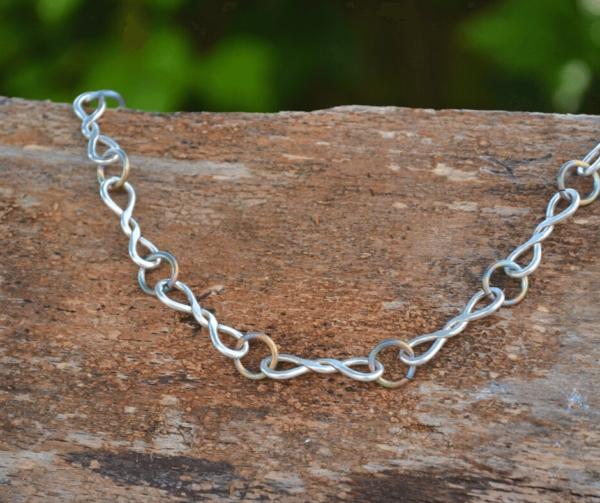 Handgemaakte zilveren schakelketting met titanium