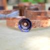 armband van koper met bloem van titanium