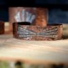 Mooie gehamerde koperen armband met details van sterling zilver.