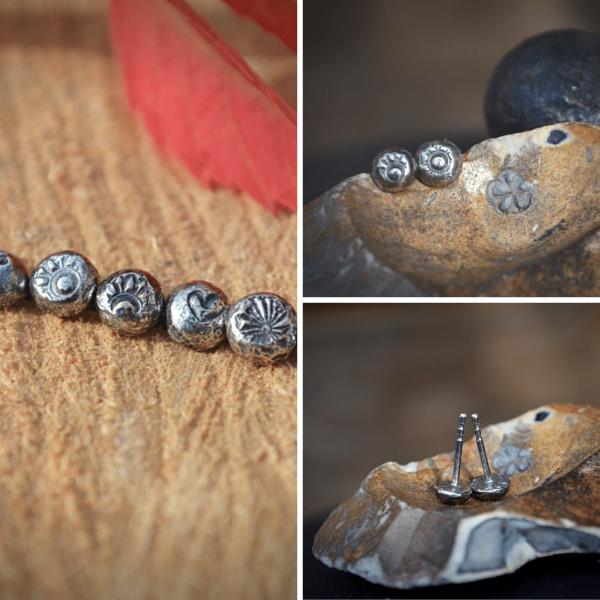"""Oorknopje van zilver handgemaakt met """"fossiele"""" afdruk"""