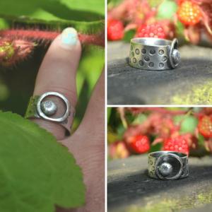 Opengewerkte zilveren ring handgemaakt met bloemafdruk